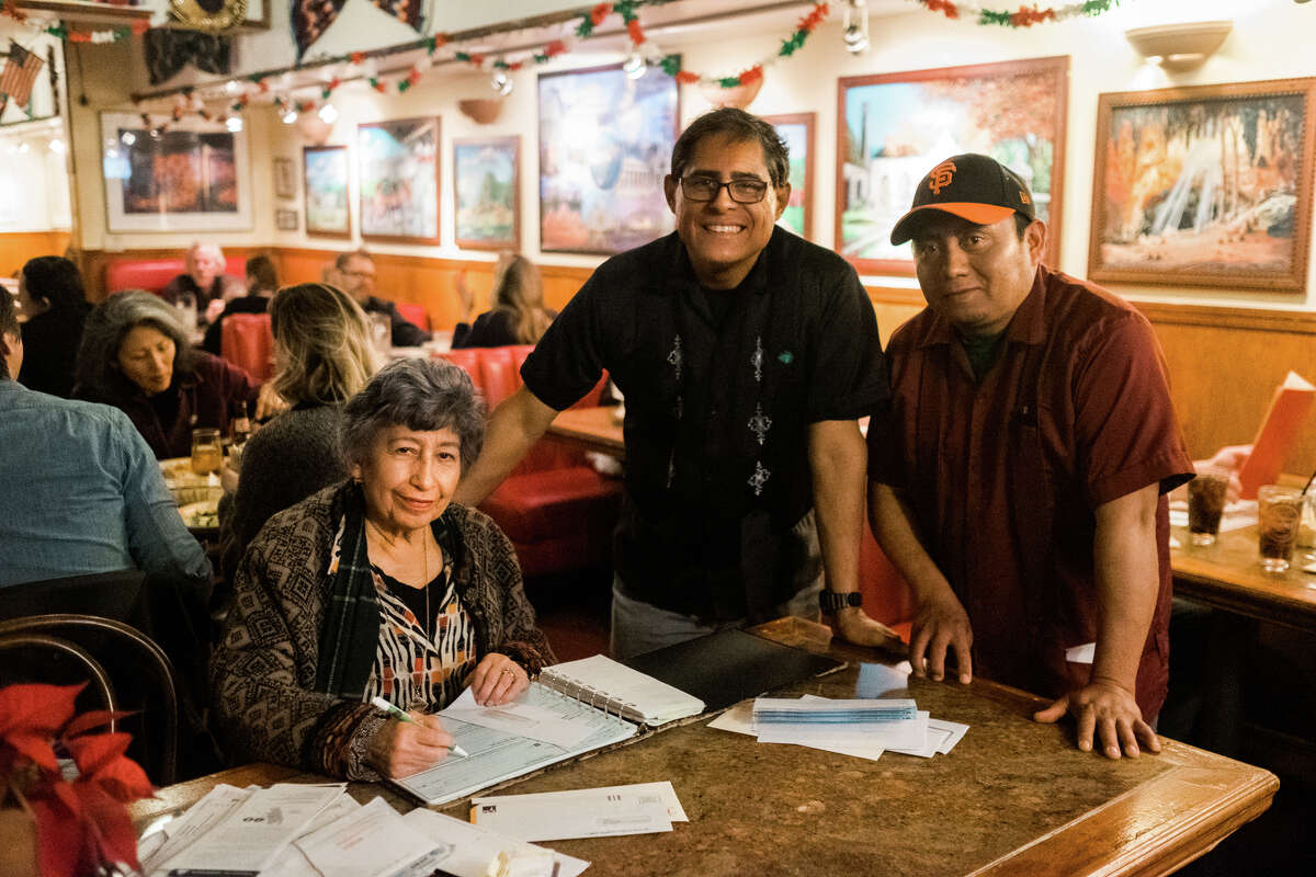 From left to right: Elmy Bermejo, her son Julio Bermejo and longtime bartender Miguel Canche.