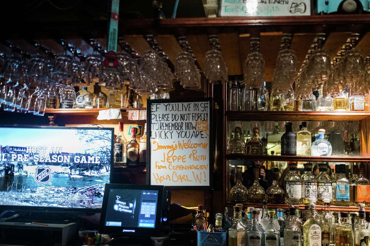 Julio Bermejo's motto is written on a whiteboard behind the bar.
