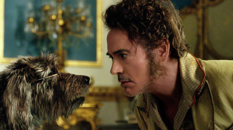 """This image released by Universal Pictures shows Dr. John Dolittle, portrayed by Robert Downey Jr., right, with Jip, voiced by Tom Holland, in a scene from """"Dolittle."""" (Universal Pictures via AP) Photo: Associated Press / COPYRIGHT © 2020 UNIVERSAL STUDIOS and PERFECT UNIVERSE INVESTMENT INC. All Rights Reserved."""