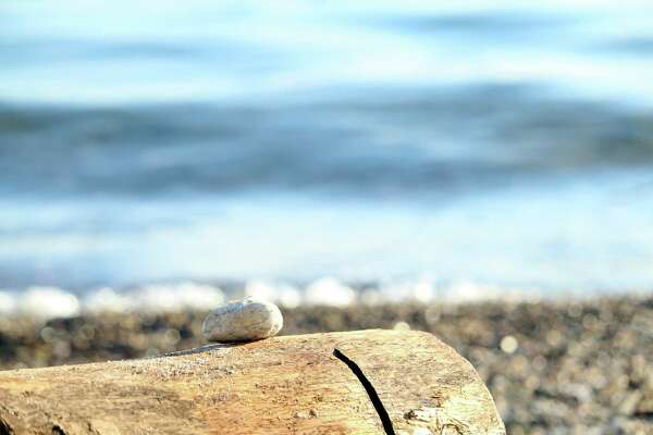 A rock shines in the sunlight at Burying Hill Beach in Westport on Jan. 15, 2020.