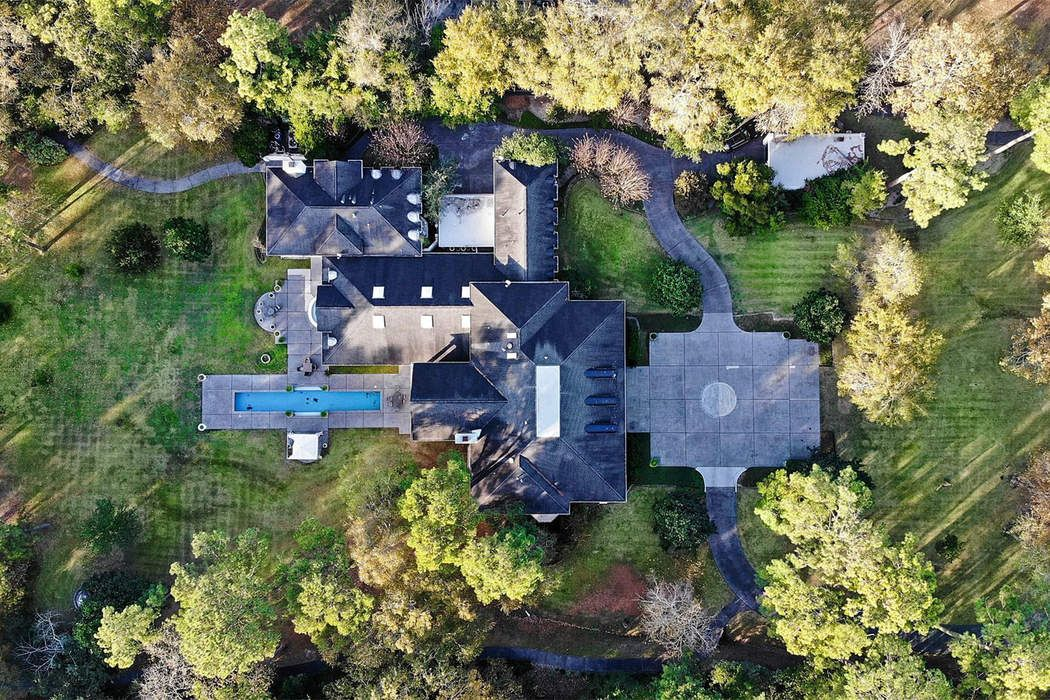 Live in your own country club at this $5M Rivercrest mansion