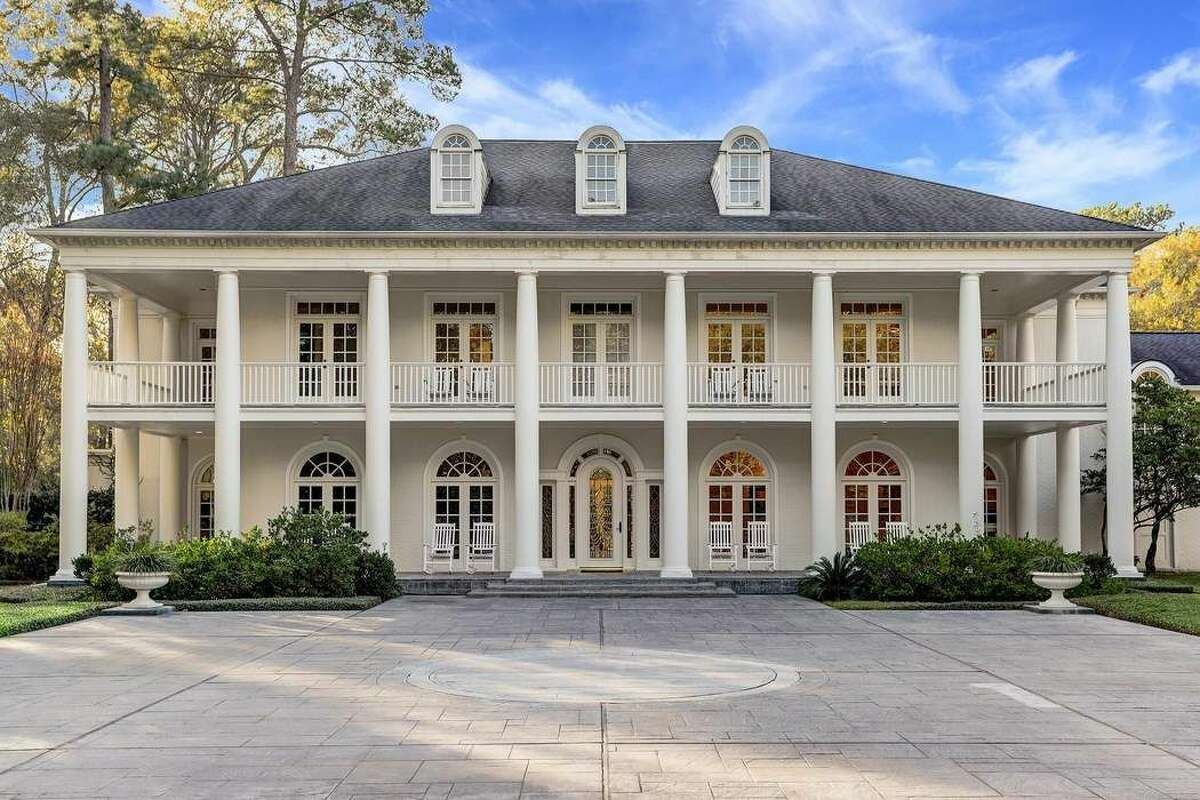 This $5 million Rivercrest mansion offers country club amenities, including two indoor and outdoor pools, a private tennis court, personal gym and 3.5 gated acres of lush scenery that hides the palatial estate.