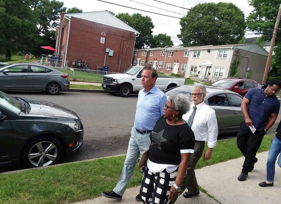 Then-Democratic gubernatorial nominee Ned Lamont takes a tour of the Second Stoneridge co-op with state Sen. Marylin Moore and Bridgeport resident Max Medina on June 5, 2018. Photo: Christian Abraham / Hearst Connecticut Media / Connecticut Post