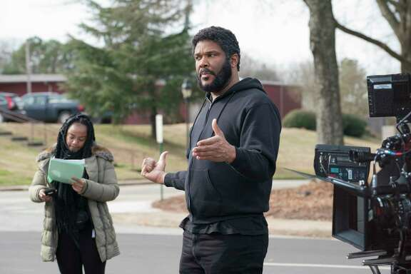 Tyler Perry directs a scene from his film A Fall From Grace