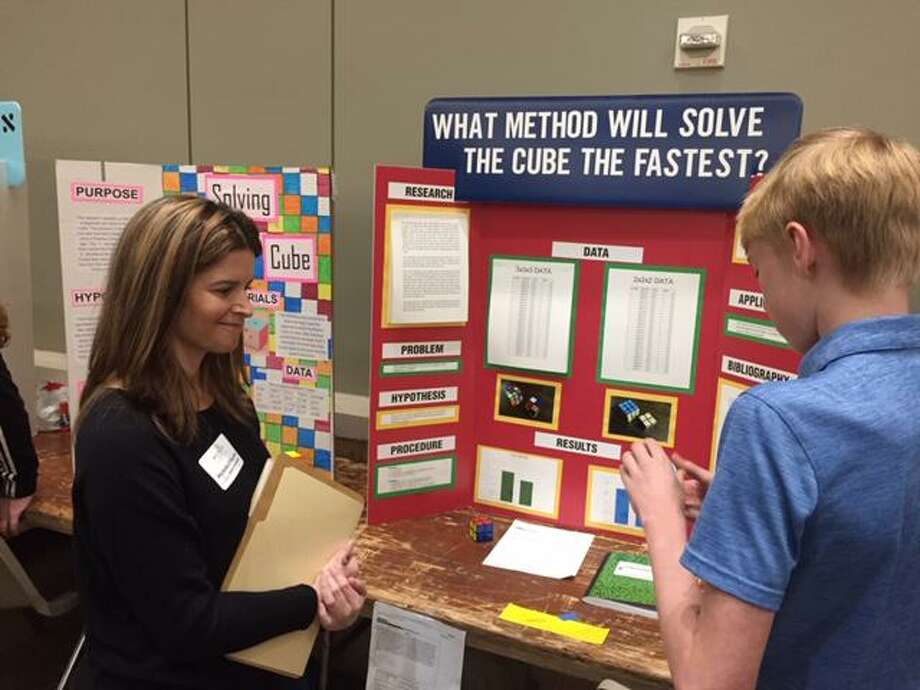 SCI://TECH is about having fun and learning and sharing STEM. Judges, like those pictured at least year's event, evaluate the projects using a rate sheet provided to them. Photo: Provided