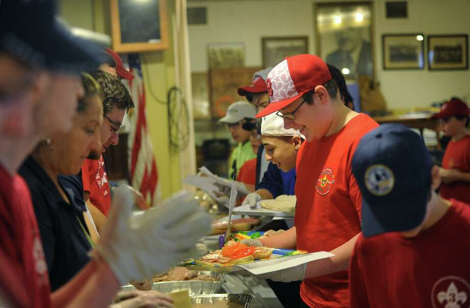 Scouts from Derby Boy Scout Troop 3 work their way down a sandwich assembly line for the group's 28th annual Super Bowl Sub Sale in 2018. Photo: Brian A. Pounds / Hearst Connecticut Media File / Connecticut Post