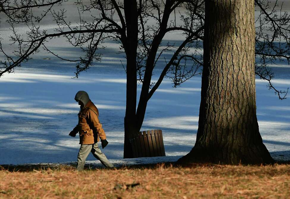 Raj Kumar of Schenectady takes a brisk walk around Iroquois Lake in Central Park on Friday, Jan. 17, 2020 in Schenectady, N.Y. (Lori Van Buren/Times Union)