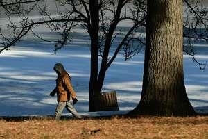 Raj Kumar of Schenectady takes a brisk walk around Iroquois Lake in Central Park on Friday, Jan. 17, 2020 in Schenectady, N.Y. (Lori Van Buren/Times Union)