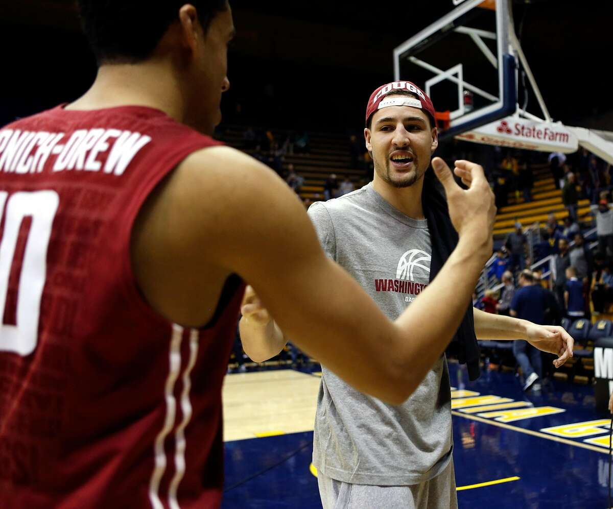 Washington State alumnus and Golden State Warrior Klay Thompson congratulates Dexter Kernich-Drew after the Cougars' 69-66 win over California during NCAA basketball game at Haas Pavilion 9n Berkeley, Calif. on Sunday, January 4, 2015.
