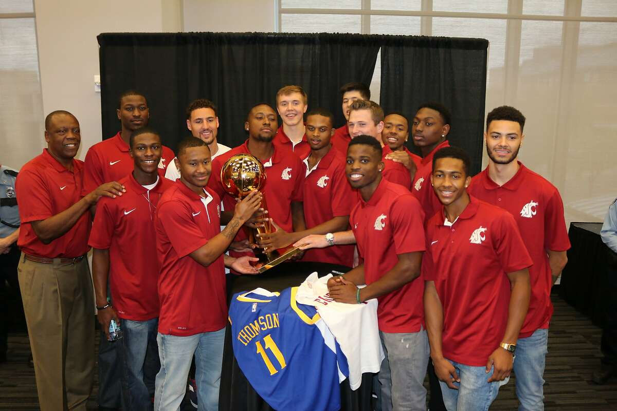 The Warriors' Klay Thompson, a Washington State alum, is joined by the Cougars' basketball team - including coach Ernie Kent - in a picture with the Larry O'Brien trophy.