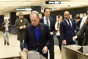 Michael Bloomberg rides BART on Friday, January 17, 2020.