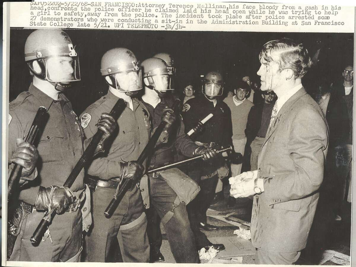 THIS IS A HANDOUT IMAGE. PLEASE VERIFY RIGHTS. HALLINANC-B- 22MAY68-MT-HO PHOTO BY UPI TELEPHOTO ATTORNEY TERENCE HALLINAN CONFRONTS POLICE OFFICER WHO HE SAID HIT HIM DURING A SIT-IN AT THE SAN FRANCISCO STATE COLLEGE ADMINISTRATION BUILDING MAY 21, 1968.