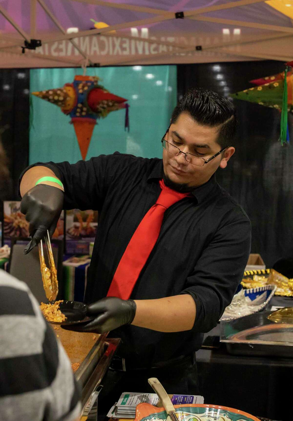 Mamacitas Mexican Restaurant served beans, rice and tamales and this year's annual Taste of the Town event at the Woodlands Waterway Marriott, Thursday, Jan. 16, 2020. The Woodlands Chamber of Commerce has held the event for 34 years and has drawn 2,000-3,000 this year.