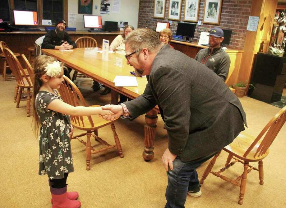 State Rep. Phil Green shakes the hand of Rebecca Bouvrette, 5. (Sara Eisinger/Huron Daily Tribune)