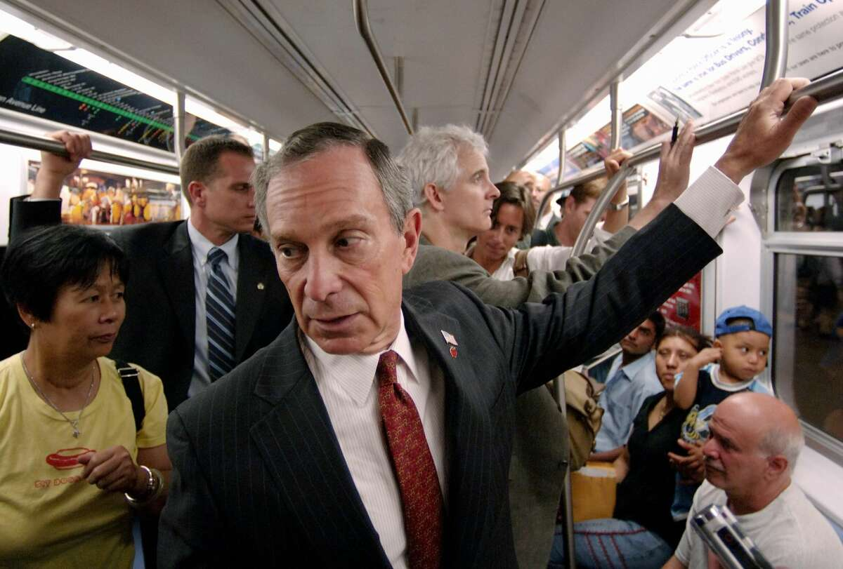 FILE - New York City Mayor Michael Bloomberg rides on the subway to City Hall July 7, 2005.