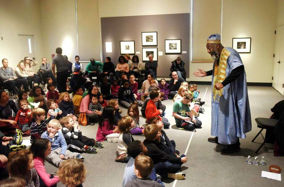 "Master storyteller Eshu Bumpus delivers an African and African American storytelling performance during the annual Martin Luther King Jr. Family Day at the Bruce Museum in Greenwich in 2017. At this year's event on Monday, Jan. 20, there will be two performances by Karima A. Robinson of ""A So-Long Journey: The Early Years of Phillis Wheatley."" Wheatley was the first published African-American woman poet and a leading figure in the early abolitionist movement. Photo: Tyler Sizemore / Hearst Connecticut Media File Photo / Greenwich Time"
