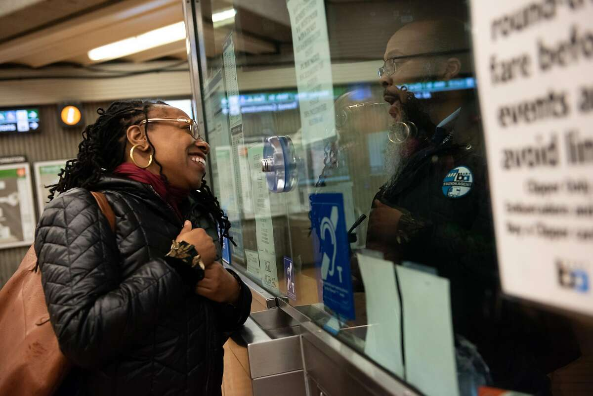 Lateefah Simon, BART's new board president and a single mom who is legally blind, speaks to a BART employee at the Richmond BART station during her morning commute on January 16, 2020 in Richmond, Calif.