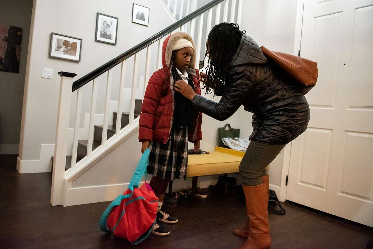 Lateefah Simon, BART's new board president and a single mom who is legally blind, gets her daughter Lelah ready for a Lyft ride to pick them up in order for Lelah to get to school on January 16, 2020 in Richmond, Calif.