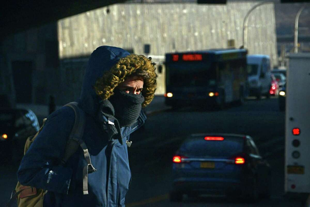 A pedestrian is bundled up as they cross Madison Ave. on frigid day on Friday, Jan. 17, 2020 in Albany, N.Y. (Lori Van Buren/Times Union)
