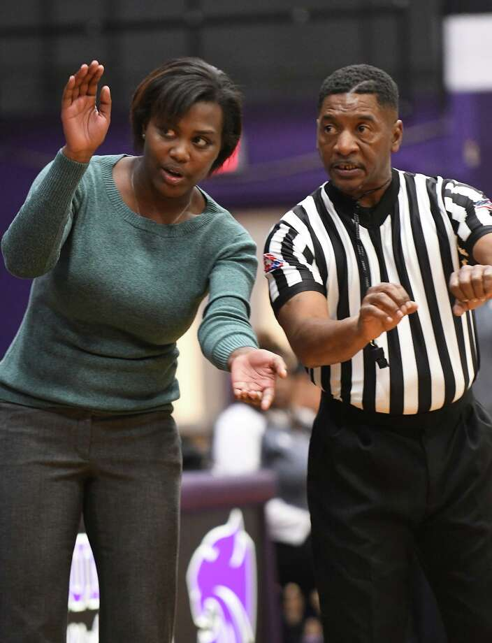 Humble Head Girls Basketball Coach Jessica Gaines, left, works for a call with a game official during the second quarter of their district matchup at Humble High School on Dec. 17, 2019. Photo: Jerry Baker, Houston Chronicle / Contributor / Houston Chronicle