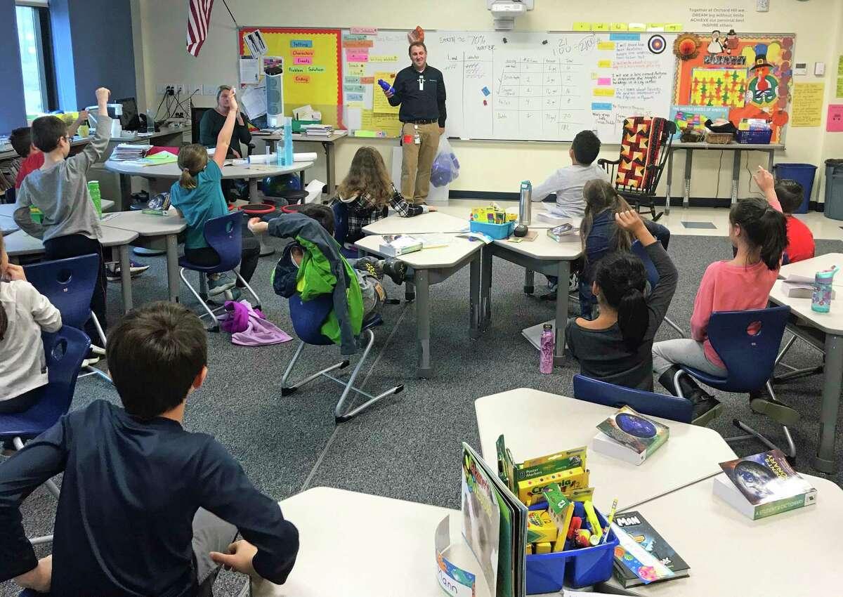 A Connecticut Water employee teaches a class of third-graders through the Water Drop Watchers program.