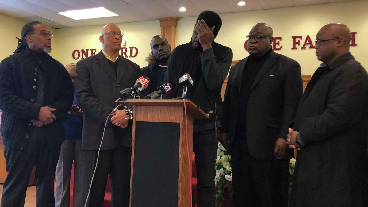Family members and local clergy called for a federal investigation into the slaying of Mubarak Soulemane by state police Friday. Here, Saeed Soulemane speaks.