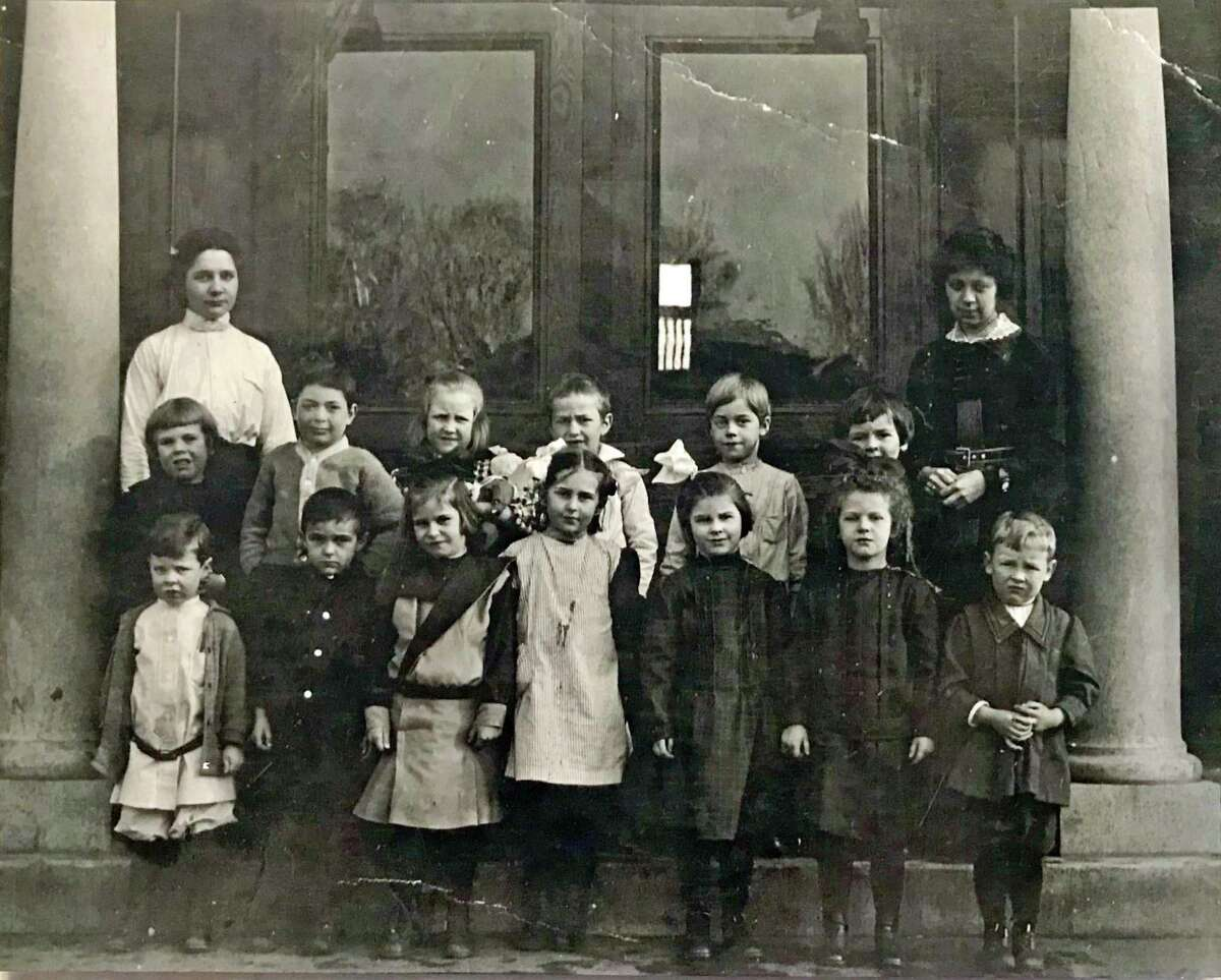 Agnes Lowe, first row, third from right, in school photo in Collinsville, CT taken in 1913 or 1914. After being orphaned at 9, she left school and went to work in a needle factory.