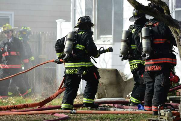 Westport, Norwalk, and Fairfield firefighters battle a blaze Friday, January 17, 2019, at 18 Vani Court in Westport, Conn. The home was unoccupied at the time of the fire.
