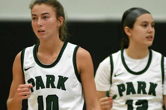 Kingwood Park senior guard Chloe Gresham (10) and freshman guard Matti McDaniel (12) take the floor for the start of the 2nd quarter against Montgomery in their district matchup at KPHS on Dec. 3, 2019.