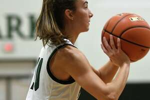 Kingwood Park senior guard Chloe Gresham sets for a shot against the Montgomery defense in the 2nd quarter of their district matchup at KPHS on Dec. 3, 2019.