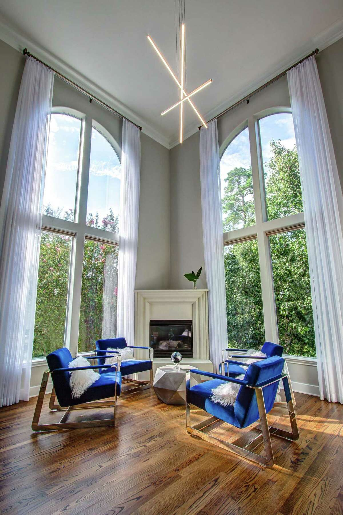 LED lights make this abstract chandelier from Visual Comfort possible. It's in a Logan Park home designed by Missy Stewart Designs.