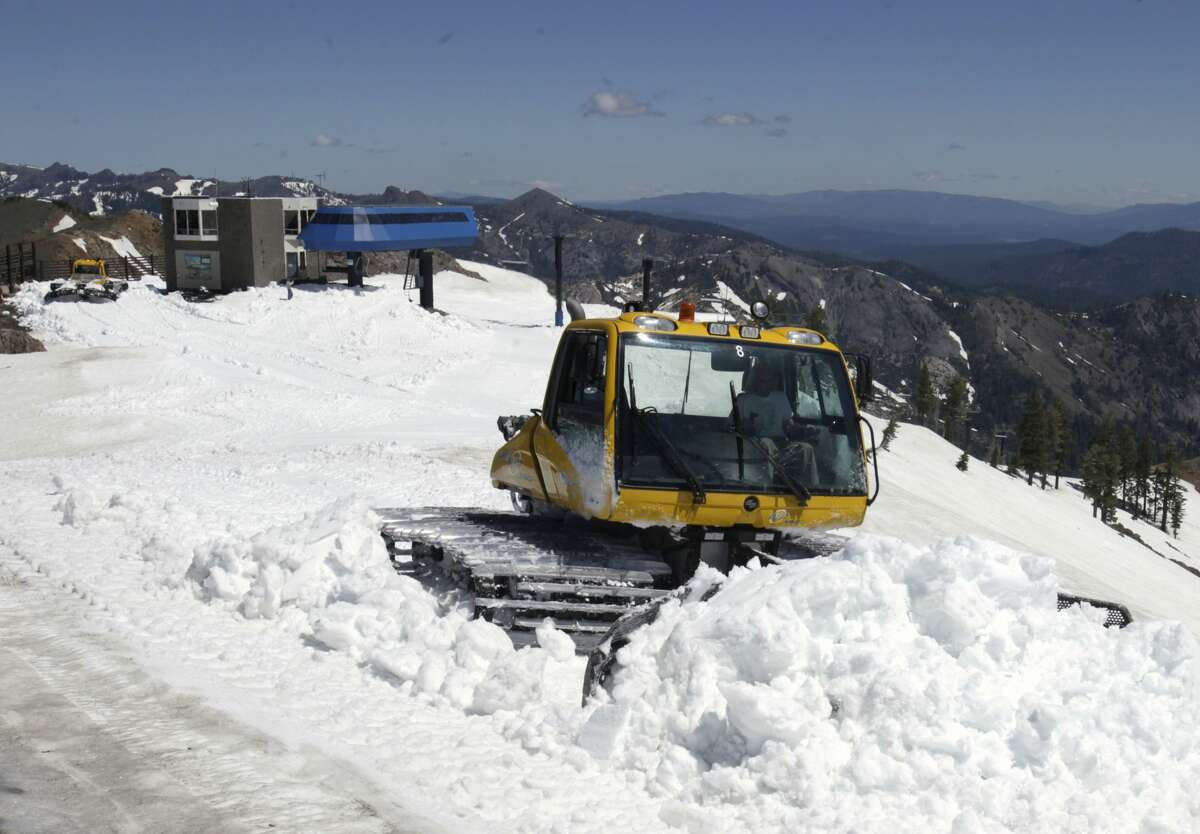 FILE- In this June 30, 2011 file photo, a snow cat grooms one of the trails at Alpine Meadows Ski Resort near Tahoe City, Calif.