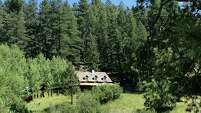 The cabin that Robert Oppenheimer built in the mountains of northern New Mexico still stands. He called it Perro Caliente.