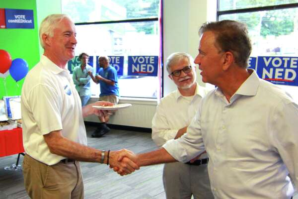 Then-gubernatorial candidate Ned Lamont, right, greets former Bridgeport Mayor Bill Finch as Lamont celebrates with supporters at the opening of a campaign office in Bridgeport in 2018.