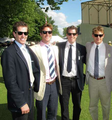 "Olympic rowers Cameron and Tyler Winklevoss meet actors Armie Hammer and Josh Pence, who play the twin brothers from Greenwich in the film ""The Social Network,"" while attending a professional rowing competition in July in Henley-on-Thames, England. The upcoming David Fincher film depicts the brothers' legal battle against Facebook founder Mark Zuckerberg, a former Harvard University classmate who they say stole their idea for the site. From left: Cameron Winklevoss, Hammer, Tyler Winklevoss and Pence. Photo: Contributed Photo / Greenwich Time Contributed"