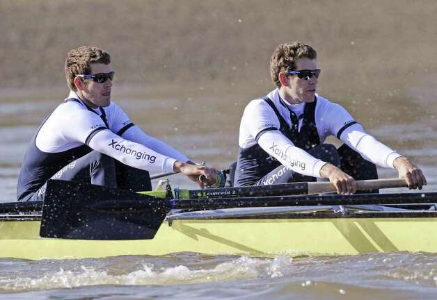Oxford University's American twins Tyler, left, and Cameron Winklevoss pull together during a training session on the River Thames in London in April, 2010, for the annual University Boat Race between Oxford and Cambridge universities. Photo: Contributed Photo / Greenwich Time Contributed