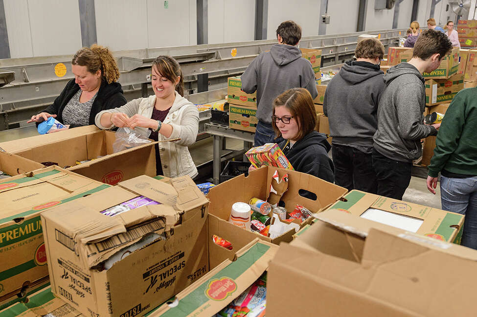 Volunteers sort food and donated items for the Regional Food Bank