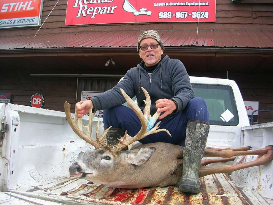 Remus' Hank Todd shows the 22-point buck he shot during the bow season. (Courtesy photo)