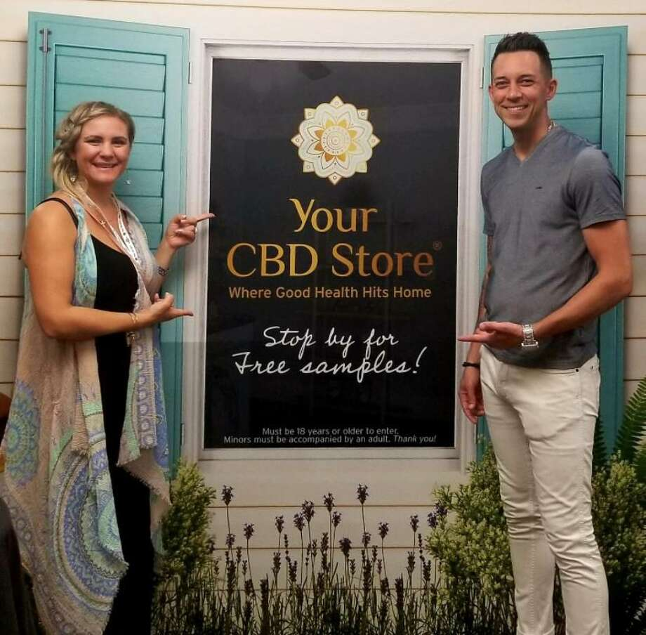 Clayton Percy, domestic franchisee director, right, and Jillian Shipchack, events coordinator, for Your CBD Stores, opened the first Connecticut-based Your CBD Store in Milford during June, 2018. There are now 22 stores in the state, with ten leases pending. Photo: Contributed / Connecticut Post