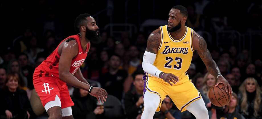 PHOTOS: 2019-20 Rockets game-by-game LOS ANGELES, CALIFORNIA - FEBRUARY 21: LeBron James #23 of the Los Angeles Lakers backs in on James Harden #13 of the Houston Rockets during a 111-106 Laker win at Staples Center on February 21, 2019 in Los Angeles, California. (Photo by Harry How/Getty Images) >>>See how the Rockets have fared in each game this season ... Photo: Harry How/Getty Images