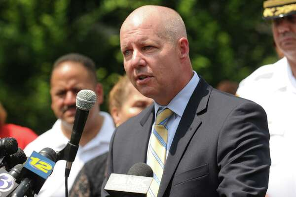 Mike Lawlor, then Connecticut's undersecretary for criminal justice, discusses efforts to crack down on gun violence outside the Margaret Morton Government Center in Bridgeport in 2014.