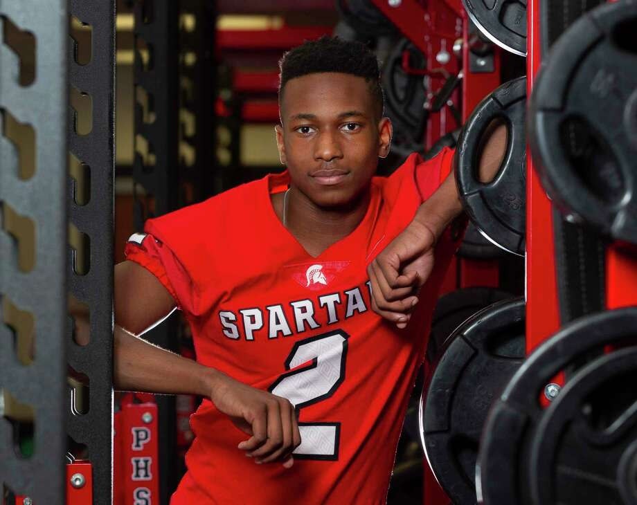 Porter wide receiver Baron Bradley poses for a portrait in the program's weight room at Porter High School, Tuesday, Jan. 14, 2020, in Porter. The Incarnate Word commit received The Courier's Grand Milton Ironman award, which is given to the player who best exemplifies overcoming adversity and inspiring others. Bradley's father died in May 2016 from pancreatic cancer. Photo: Jason Fochtman, Houston Chronicle / Staff Photographer / Houston Chronicle © 2020