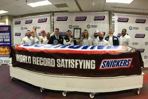 The Mars Wrigley plant in Waco recently unveiled a Snickers bar that measures 24 inches high by 26 inches wide, and weighs more than two metric tons, according to a news release.
