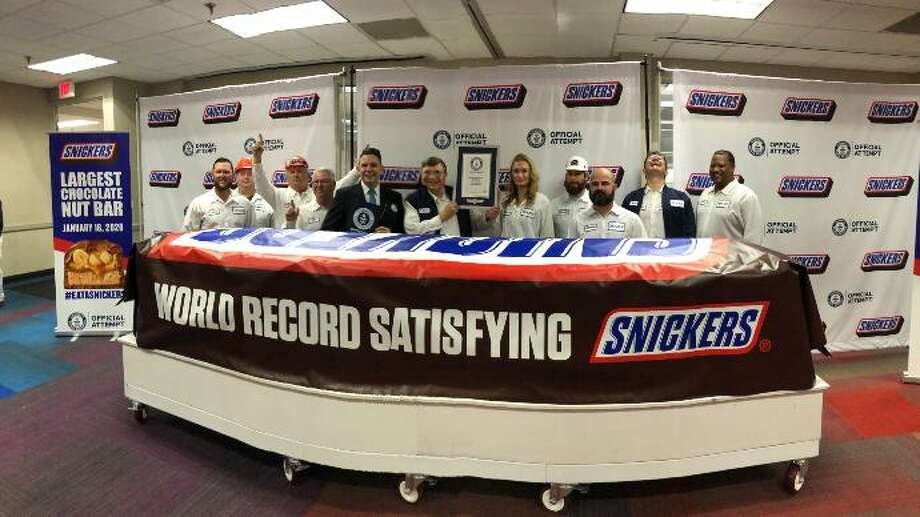 The Mars Wrigley plant in Waco recently unveiled a Snickers bar that measures 24 inches high by 26 inches wide, and weighs more than two metric tons, according to a news release. Photo: Drew Anthony Smith/AP Images