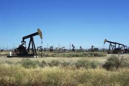 This June 12, 2017 photo shows pumpjacks operating in the western edge of California's Central Valley northwest of Bakersfield. The federal government wants to reopen over 1.7 million acres (690,000 hectacres) in California to oil and gas drilling that includes fracking on land that has been off-limits since environmentalists sued in 2013. The Bureau of Land Management issued final plans Thursday, May 9, 2019 for oil and gas leases on 800,000 acres (324,000 hectacres) of federal land mainly between the Central Coast and Central Valley.