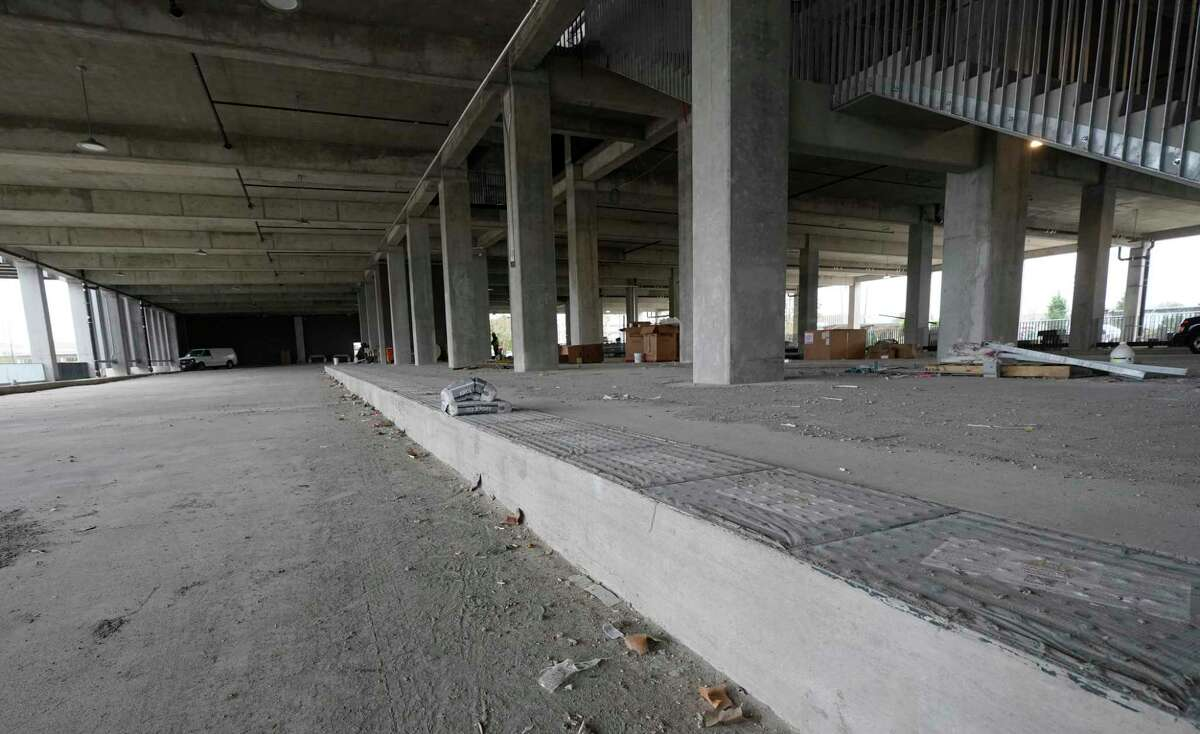 A raised platform for the rapid buses is shown on the ground level of the Uptown Westpark Transit Center on Jan. 9, 2020. The rapid transit buses will use the first level of the new transit center parking garage.