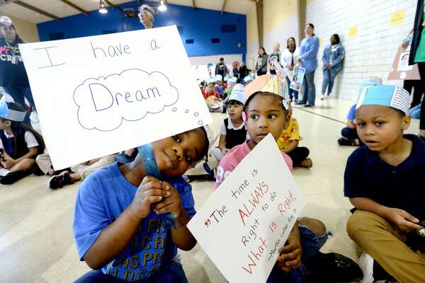 Lucas Pre-K students, including Amiyah Whitaker (left) and Za'Ryah Jones, and staff celebrated Martin Luther King, Jr., and his legacy of peace, civil rights and freedom with an assembly and parade at the school Friday. Photo taken Friday, Jan. 17, 2020 Kim Brent/The Enterprise