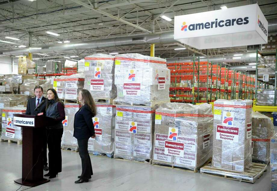 Kate Dischino, center, Americares' vice president of emergency programs, addresses a group gathered in front of pallets of supplies destined for Puerto Rico on Jan. 17, 2020, at the nonprofit's headquarters at 88 Hamilton Ave., in Stamford, Conn. At left is U.S. Sen. Richard Blumenthal, and at right is Dr. E.Anne Peterson, Americares' senior vice president of global programs. Blumenthal visited the headquarters to get a debriefing on the nonprofit's response to last week's 6.4-magnitude earthquake in Puerto Rico. Photo: Matthew Brown / Hearst Connecticut Media / Stamford Advocate