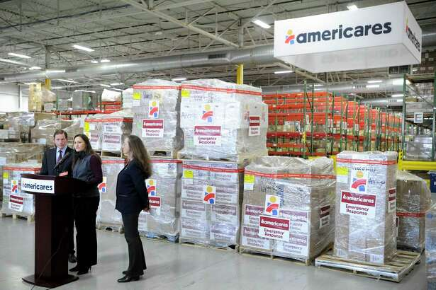 Kate Dischino, center, Americares' vice president of emergency programs, addresses a group gathered in front of pallets of supplies destined for Puerto Rico on Jan. 17, 2020, at the nonprofit's headquarters at 88 Hamilton Ave., in Stamford, Conn. At left is U.S. Sen. Richard Blumenthal, and at right is Dr. E.Anne Peterson, Americares' senior vice president of global programs. Blumenthal visited the headquarters to get a debriefing on the nonprofit's response to last week's 6.4-magnitude earthquake in Puerto Rico.