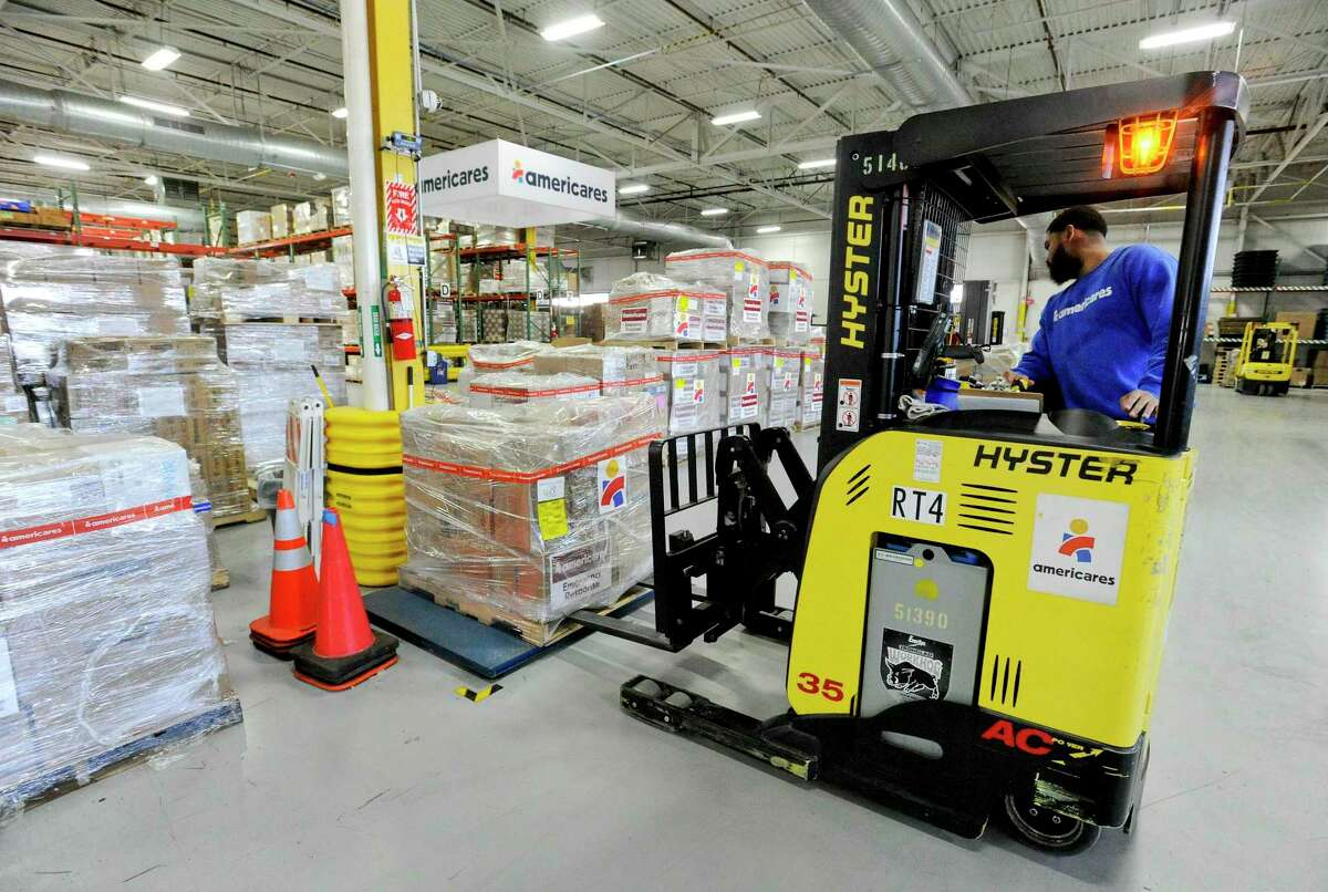Robert Morales, a senior warehouse associate, weighs a pallet of relief supplies heading to Puerto Rico on Jan. 17, 2020 at Americare's in Stamford, Conn. Americares received a PPP loan between $2 million and $5 million.